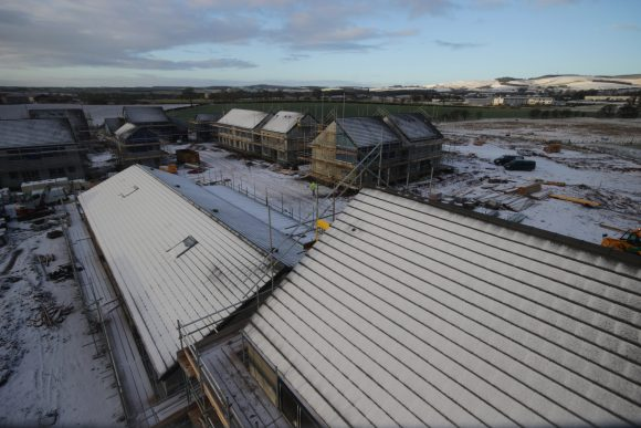 Snow begins to melt at a housing development in Duns