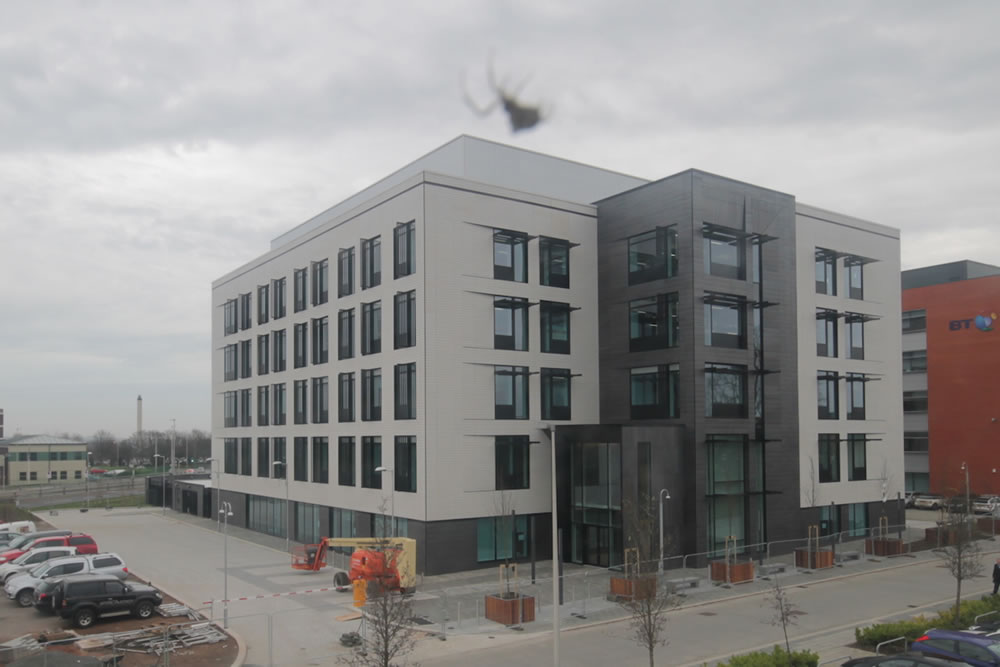 Spider spins a web on our camera system capturing The West Brom building society headquarters build