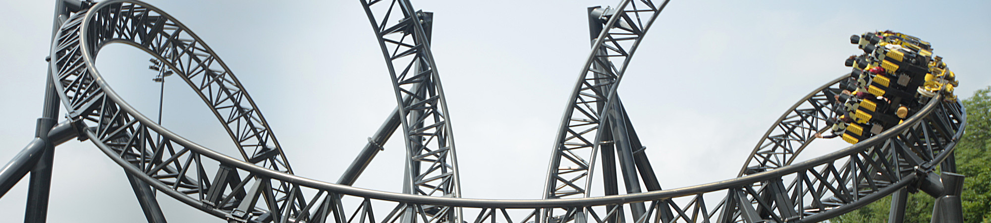 Roller coaster car passes during rapid capture at The Smiler