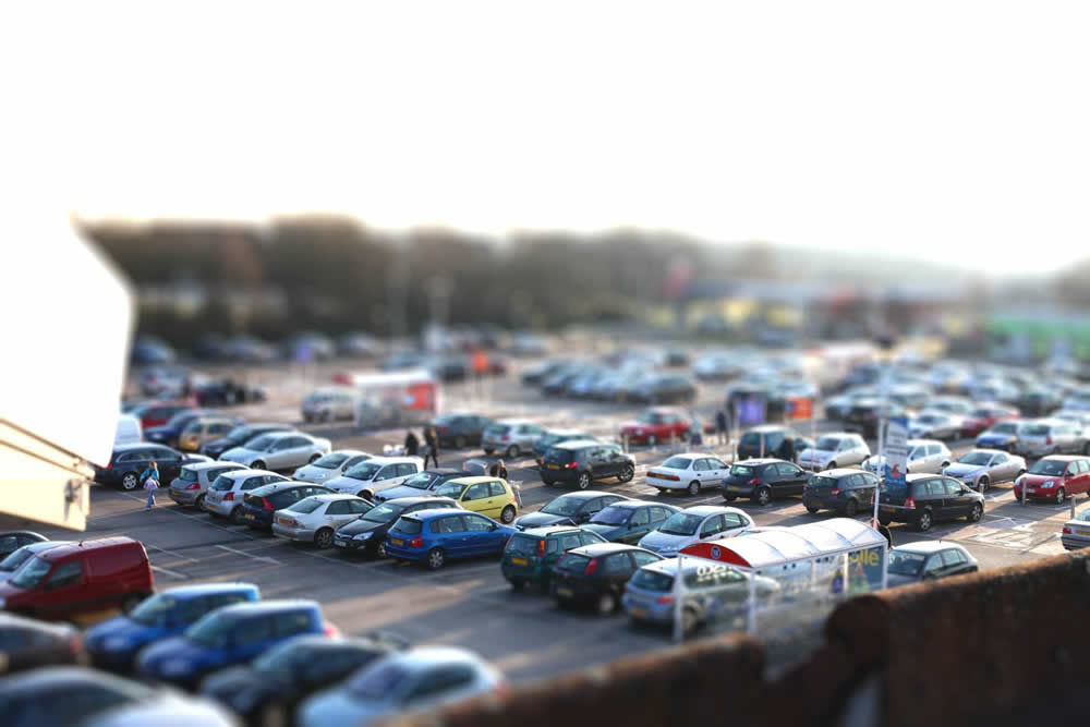 Tilt-shift shot of a car park