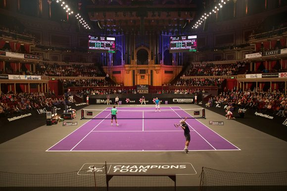 A player serves on the Champions Tour at the Royal Albert Hall