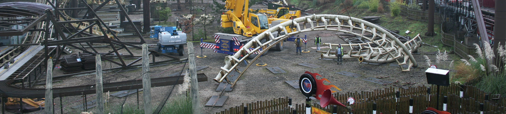 Corkscrew track being removed via a crane from the ride
