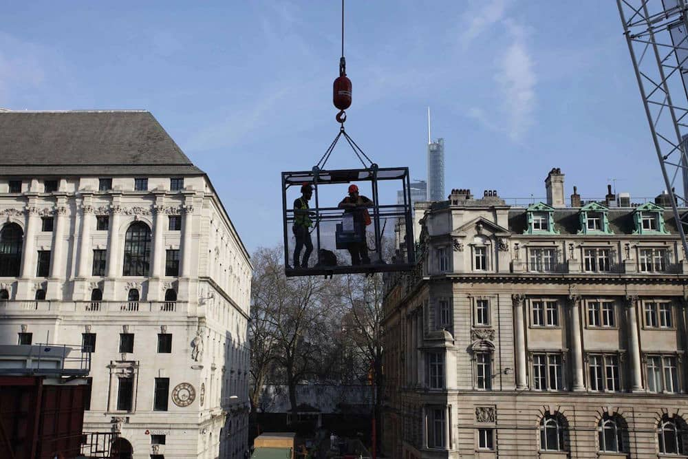 Using a crane and cage over the Moorgate Station project to access the camera system