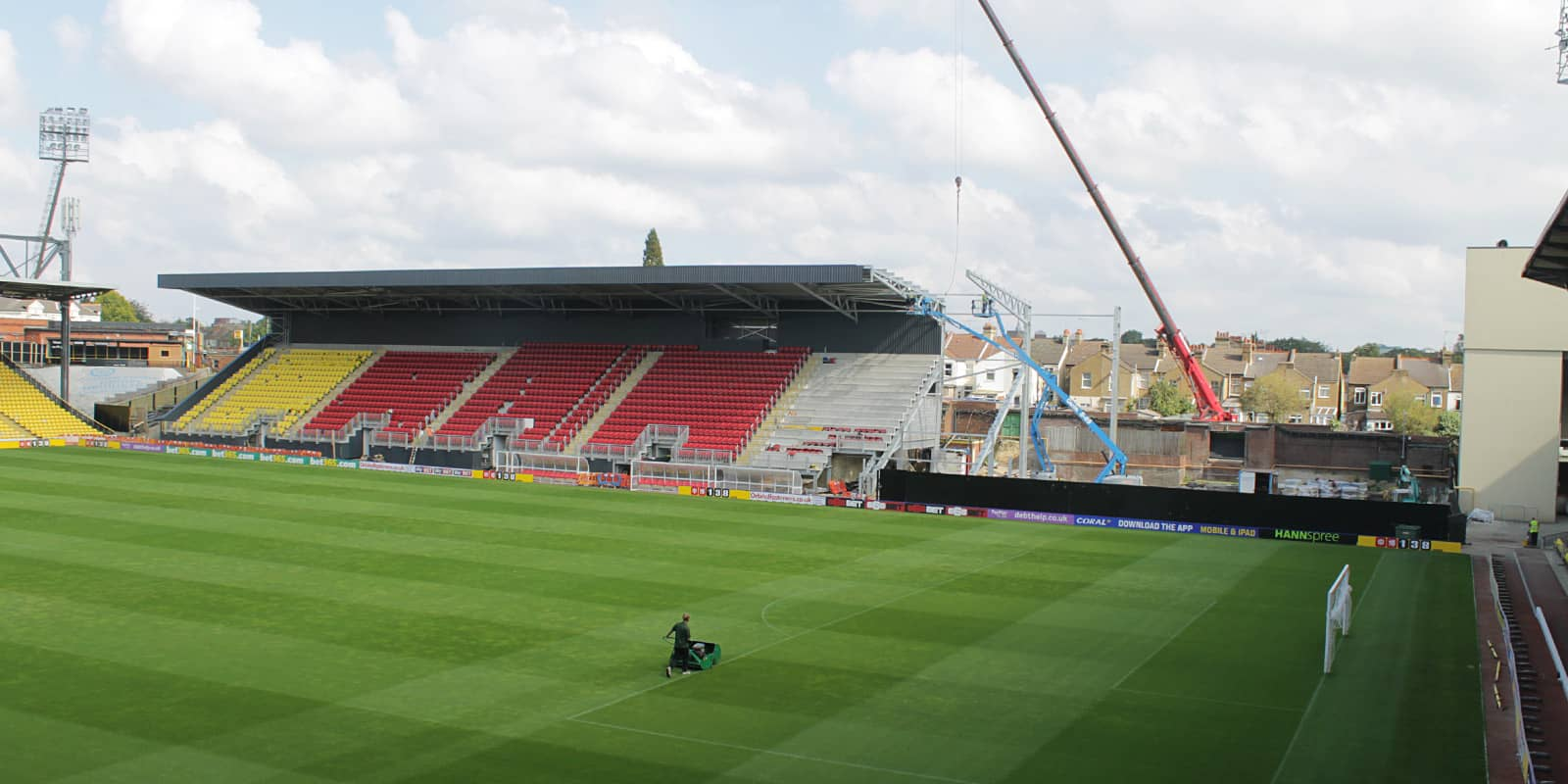 Old Main Stand being demolished with the new Sir Elton John stand under construction