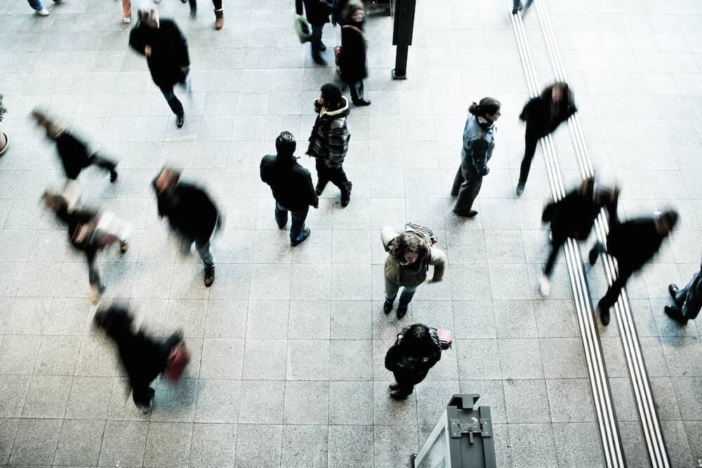 Aerial view of pedestrians, featuring motion blur.