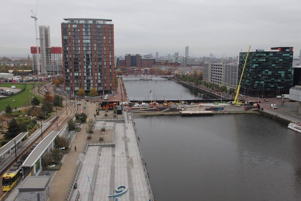 Rooftop view from the BBC building overlooking construction progress at Salford Quays.