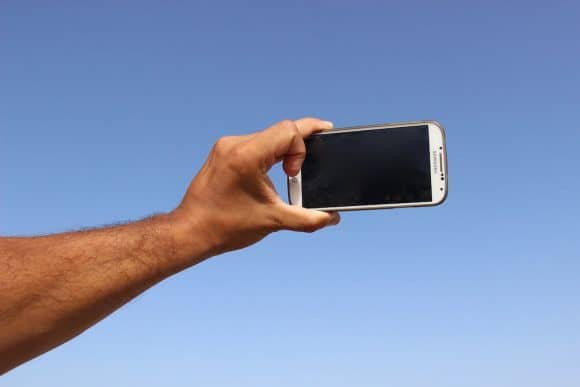 A smartphone in position to take a selfie.