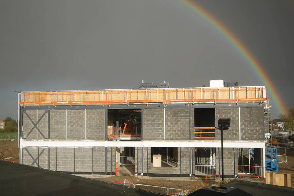 Rainbow over construction for an educational build in Saint Ives.