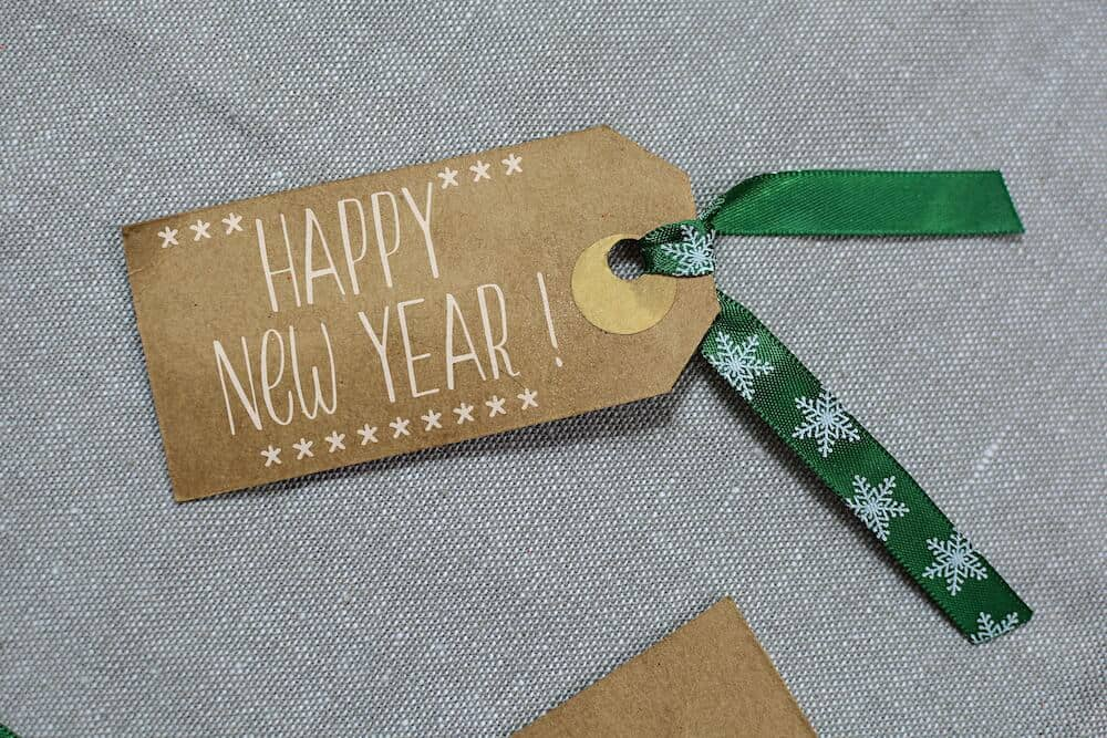 Close-up of a gift tag with a 'Happy New Year' greeting.
