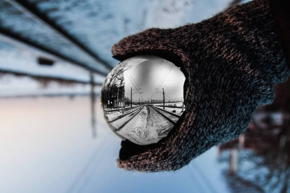 A snowy scene reflected in a spherical shape.