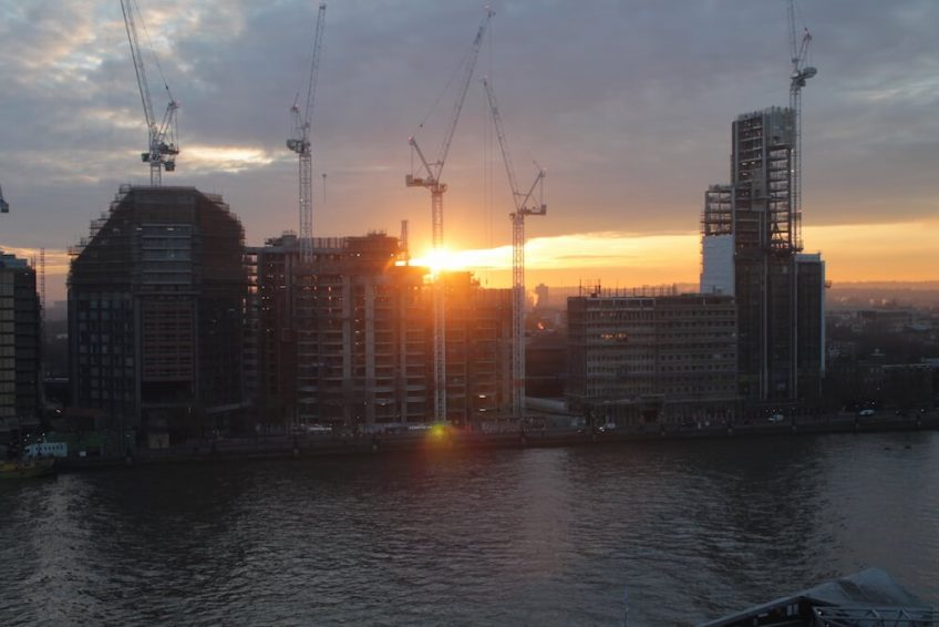 Sunrise behind St James' Corniche project situated on the banks of the Thames.