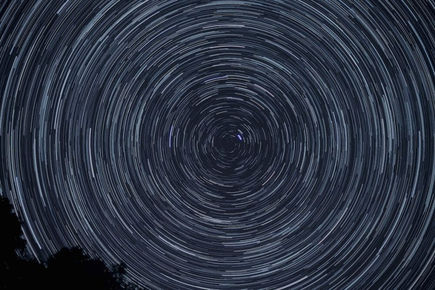 Circular celestial patterns as part of a night sky.