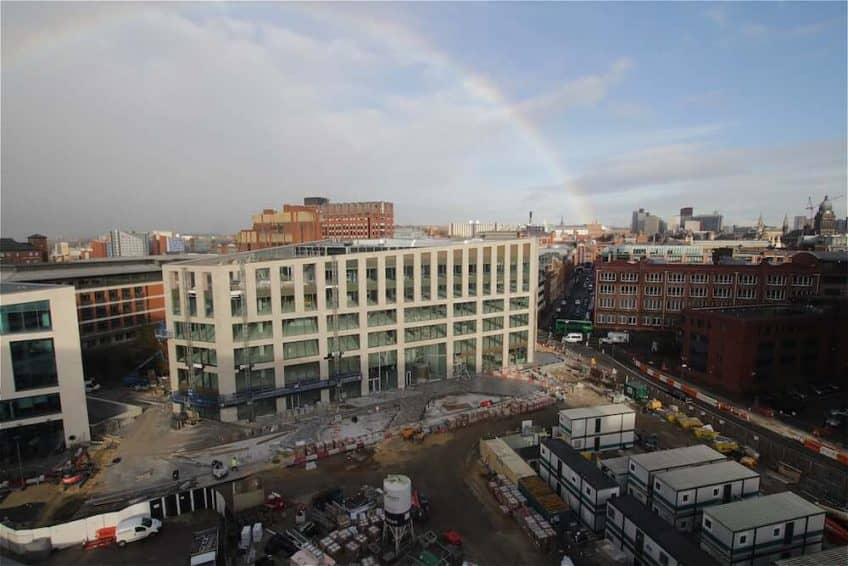 A rainbow over construction progress at Wellington Place, Leeds.