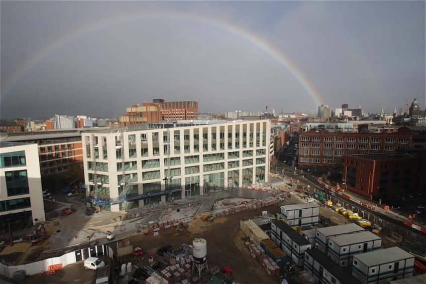 A full rainbow appears over construction progress at Wellington Place, Leeds.