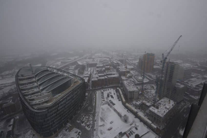 Snow batters our camera overlooking progress at Angel Gardens.