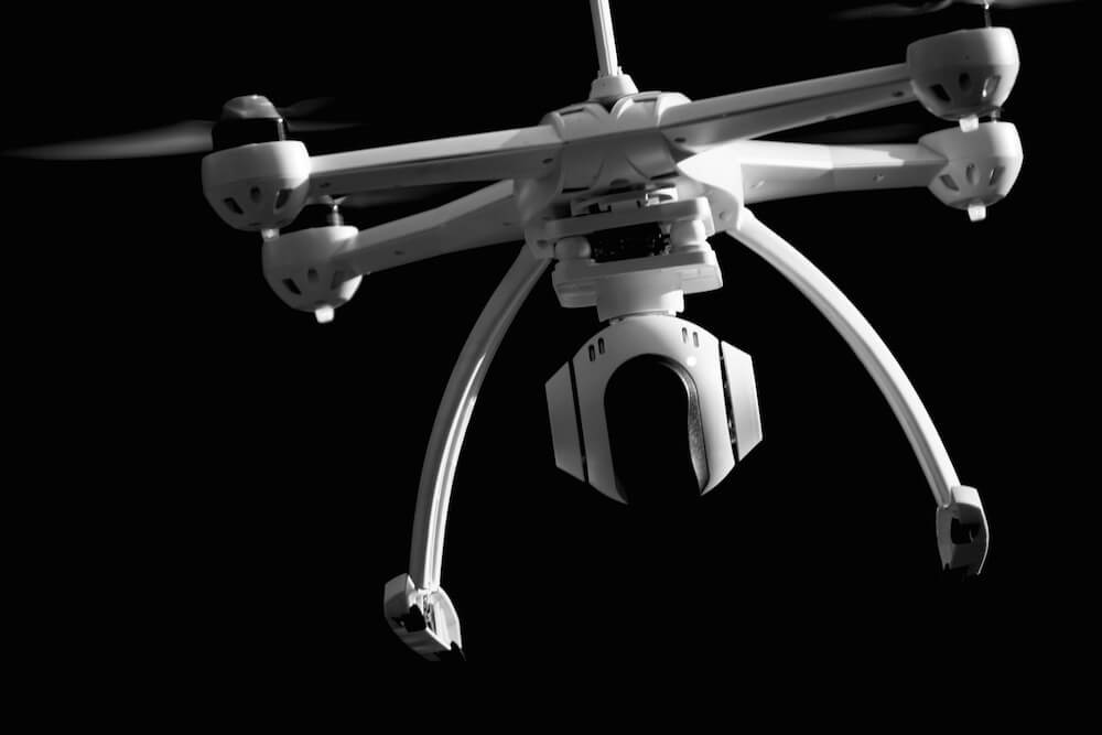 Black and white image of a quadcopter.