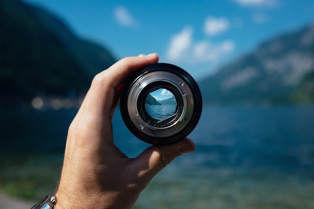 Looking through the eye of a camera lens at an idyllic landscape.