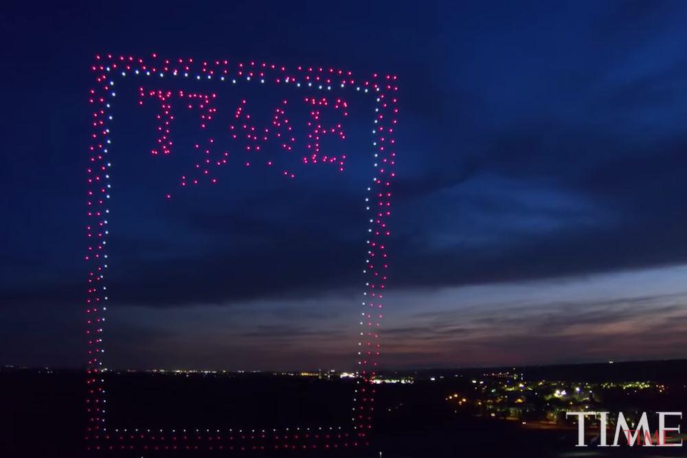A screenshot of a swarm of drones over California forming a special cover of TIME magazine.