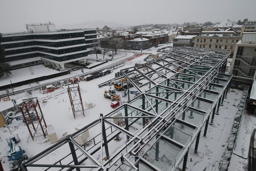 Image showing halt in construction due to snowfall during steel erection of Gloucester's new bus station