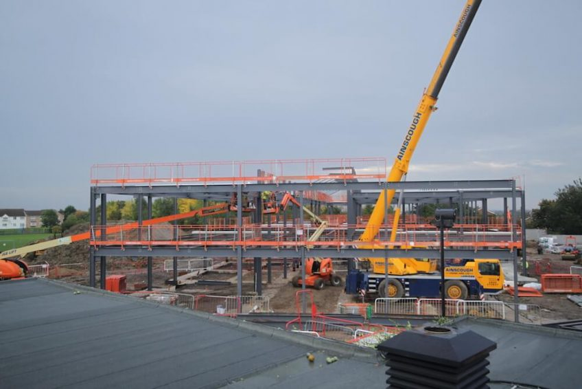 Time-lapse image of a Kier construction project, overlooking a crane and the erection of steelwork at Thorndown Primary School.