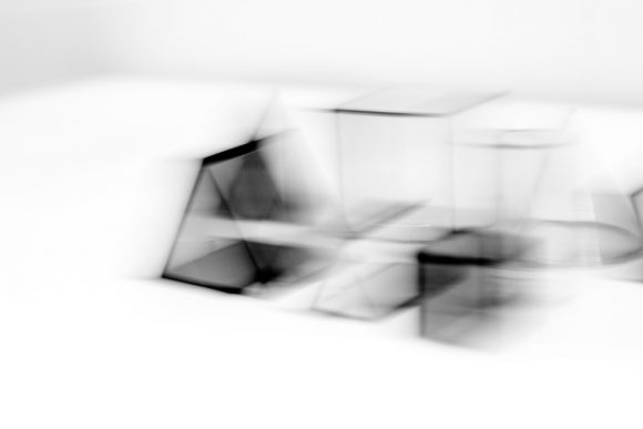 Blurred black and white composition of minimal shapes.
