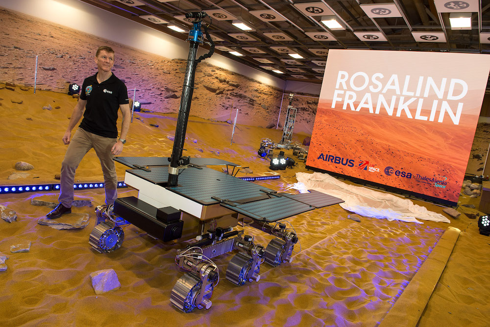 Tim Peake stands alongside newly-named Rosalind Franklin rover in Mars simulation environment during naming ceremony ahead of space mission