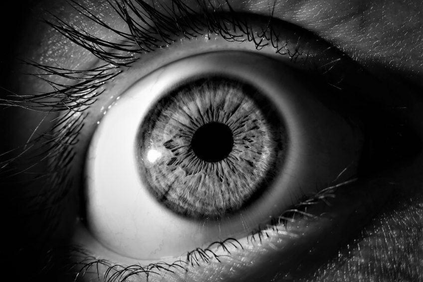 Black and white eye looking at time-lapse video