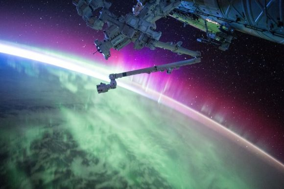 View of earth from space, featuring aurora lights.