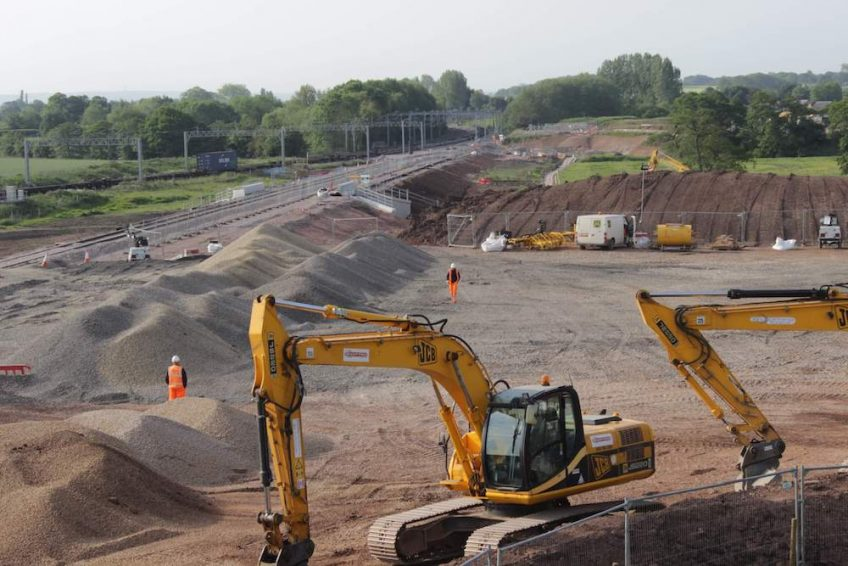 A time-lapse construction image of machinery assisting in pre-construction works at Norton Bridge.