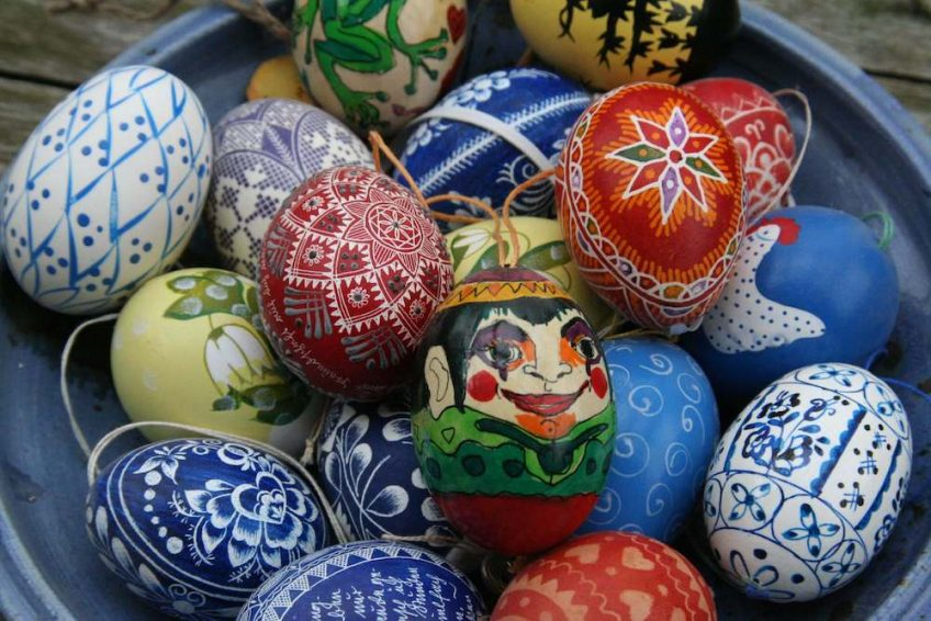 Colourfully decorated Easter eggs in a bowl.