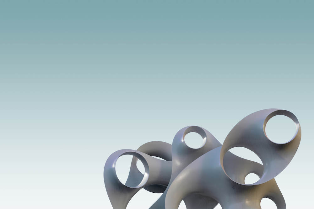 Abstract sculpture against a pale blue background.