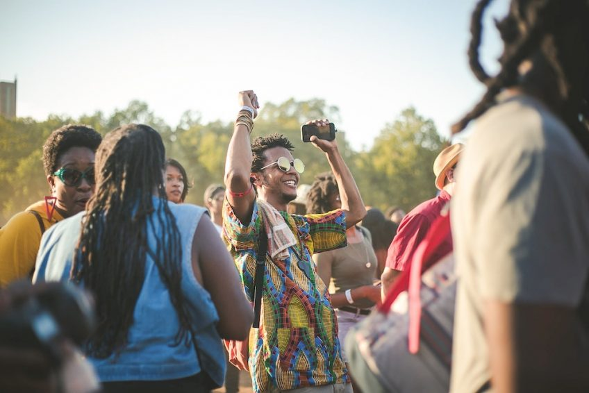 Crowds gathering in the sunshine at the afropunk festival.